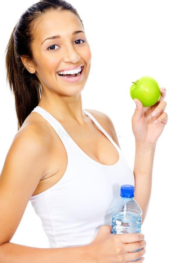 Frau mit Apfel lizenzfreie stockfotos
