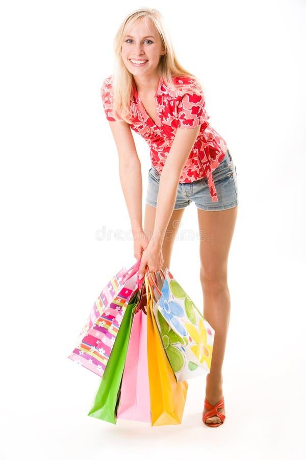 Frau mit Beuteln stockfoto