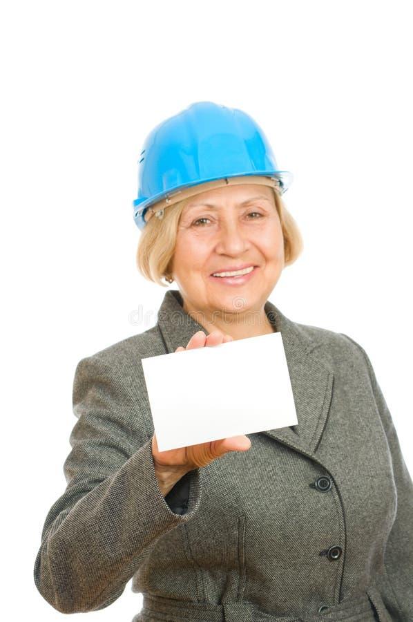 Frau mit blauem hartem Hut stockfoto
