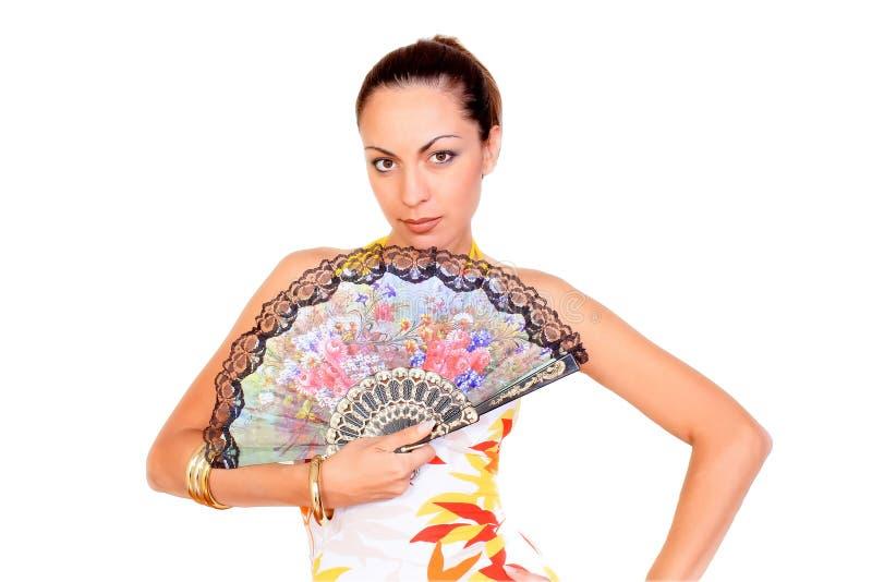 Frau mit buntem Gebläse stockfotografie