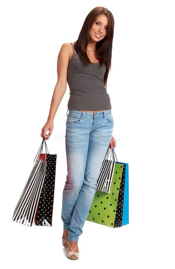 Frau mit bunten Einkaufenbeuteln. lizenzfreie stockfotografie