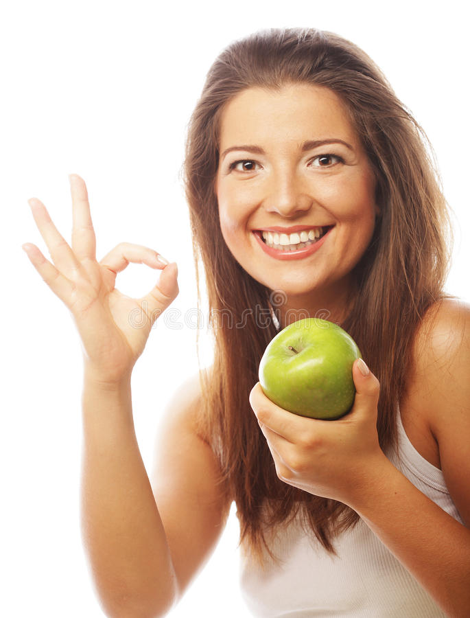 Frau mit dem grünen Apfel- und sich zeigendaumen stockfoto