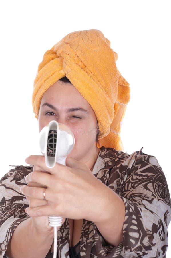 Frau mit dem Haartrockner für hai lizenzfreies stockfoto