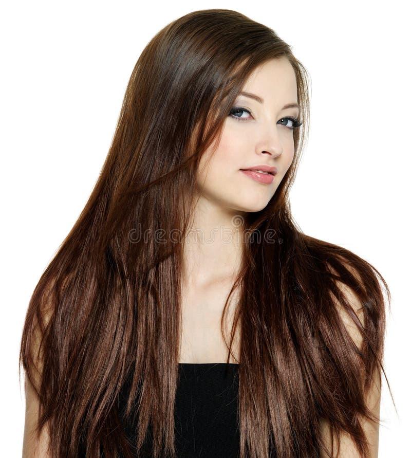 Frau mit dem langen braunen geraden Haar stockfotos