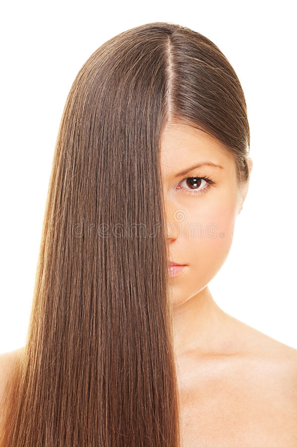 Frau mit dem langen gesunden Haar stockfoto