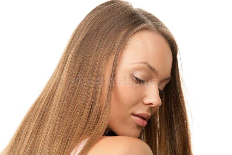 Frau mit dem langen Haar stockbild