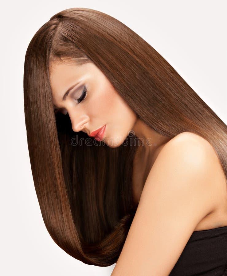 Frau mit dem langen Haar stockfotos