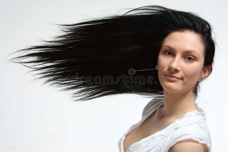 Frau mit dem langen Schönheitshaar stockfoto