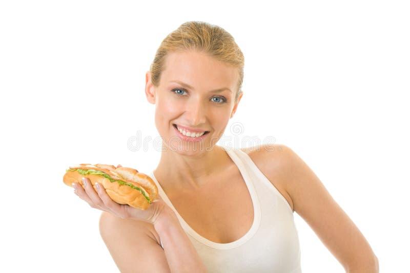 Frau mit dem Sandwich, getrennt stockbild