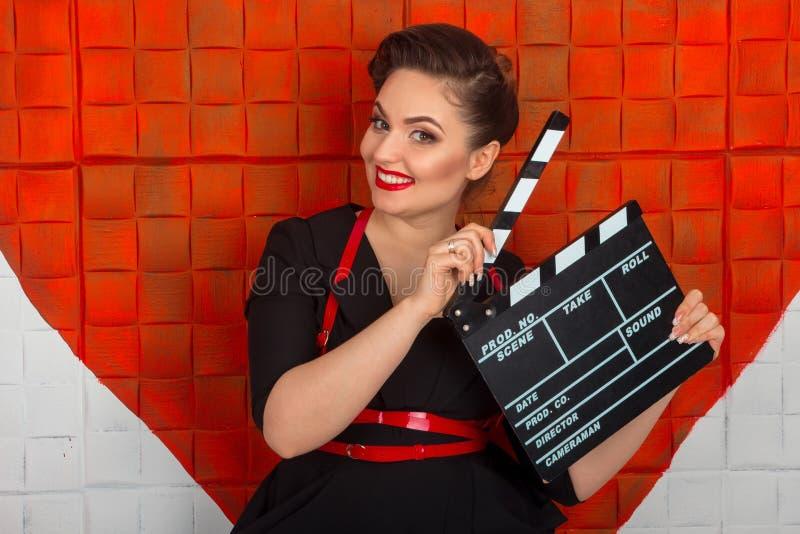 Frau mit dem Scharnierventil stockfotografie