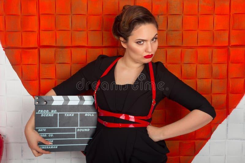 Frau mit dem Scharnierventil lizenzfreie stockfotografie
