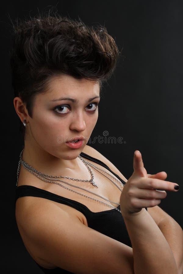 Frau mit dem spitzen Finger lizenzfreie stockfotografie