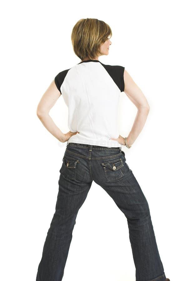 Frau mit dem weißen T-Shirt, das zurück sie dreht lizenzfreie stockfotografie