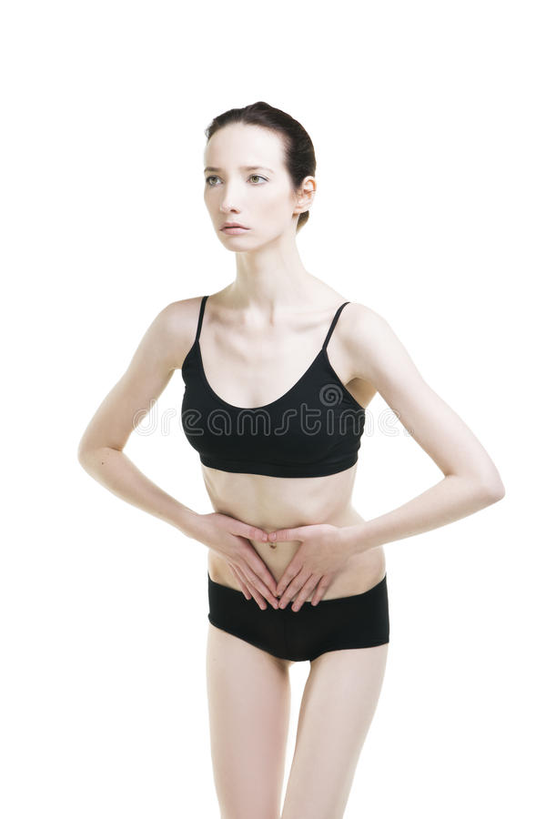 Frau mit den Abdominal- Schmerz Schmerz im menschlichen Körper lizenzfreie stockfotos