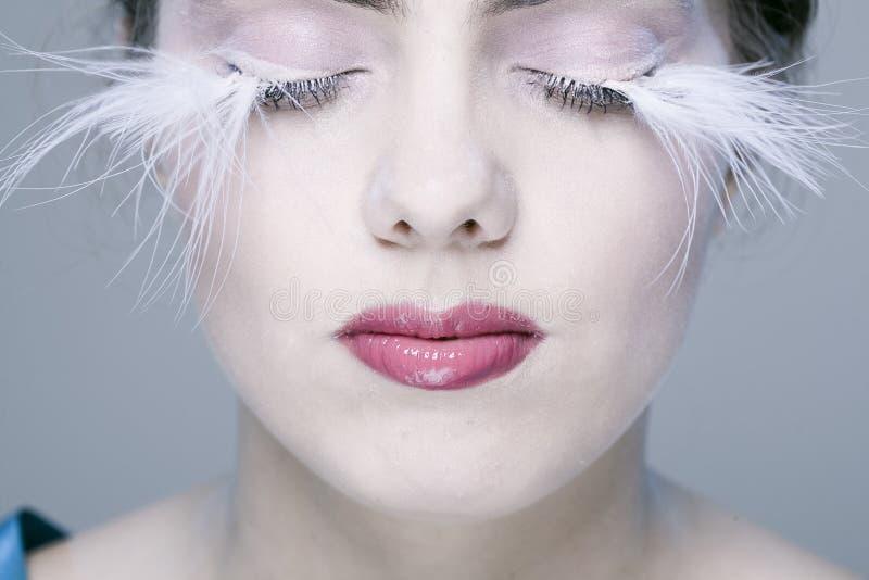 Frau mit den langen Wimpern stockfoto