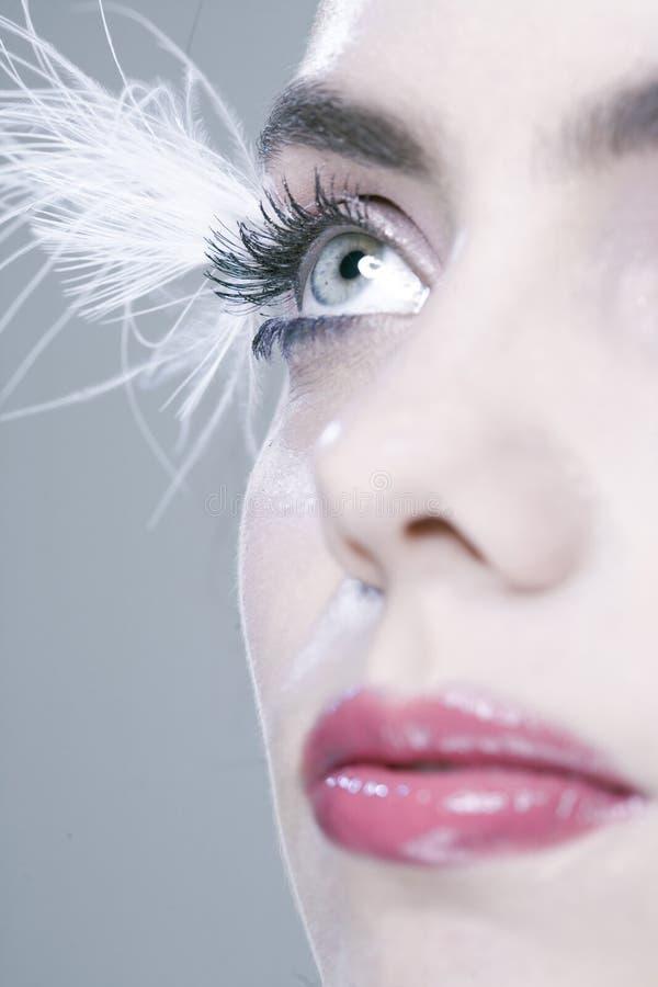 Frau mit den langen Wimpern lizenzfreie stockbilder