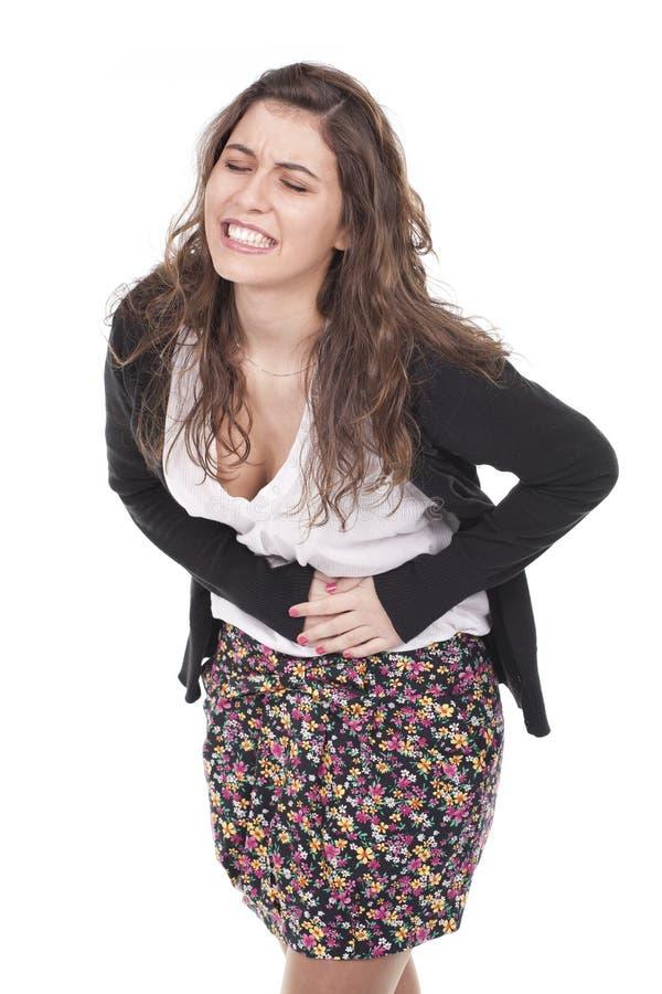 Frau mit den Schmerz in ihrem Bauch stockfotos