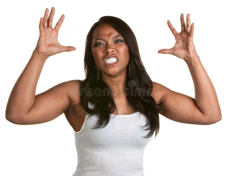 Frau mit den zusammengepreßten Zähnen lizenzfreie stockfotografie