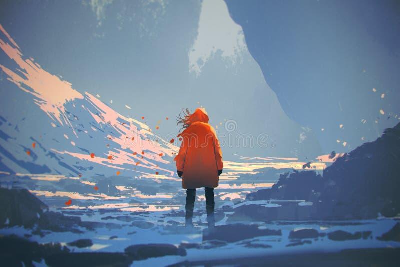Frau mit der orange warmen Jacke, die in der Winterlandschaft steht lizenzfreie abbildung