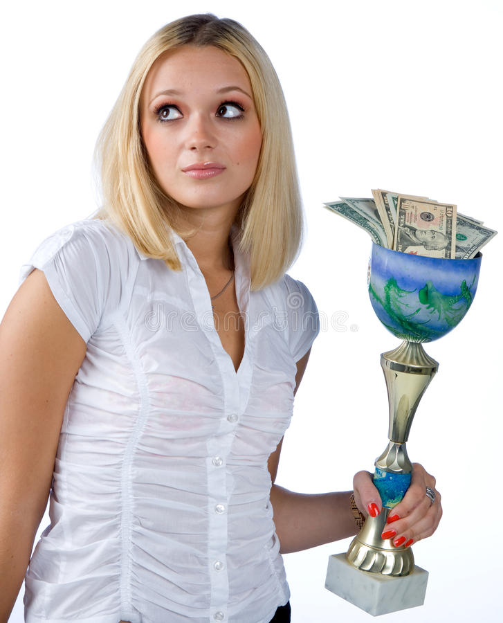 Frau mit der Trophäe voll vom Geld stockfoto