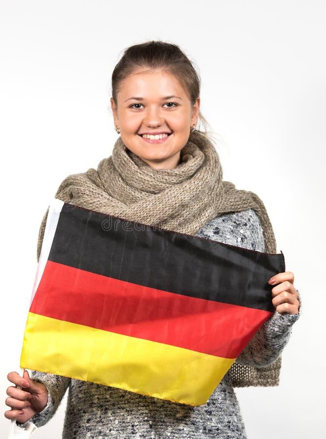 Frau mit deutscher Flagge stockbild
