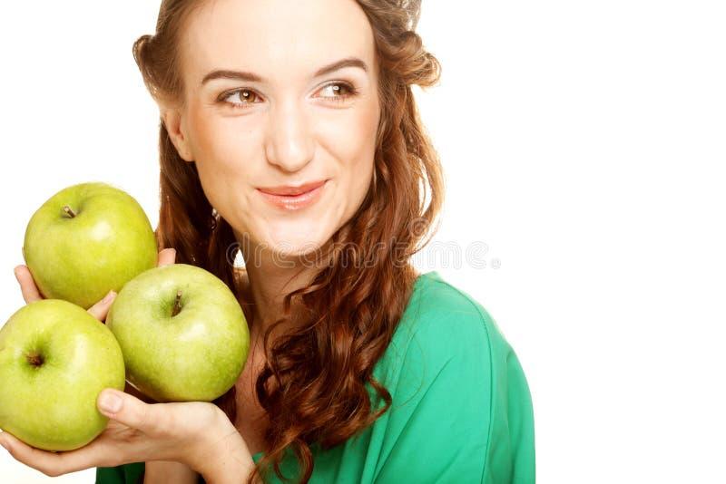 Frau mit drei Äpfeln lizenzfreie stockfotografie