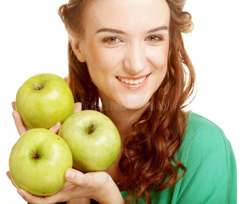 Frau mit drei Äpfeln stockfotografie