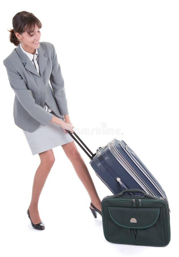 Frau mit einem Gepäck stockbilder