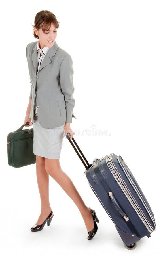 Frau mit einem Gepäck lizenzfreies stockbild