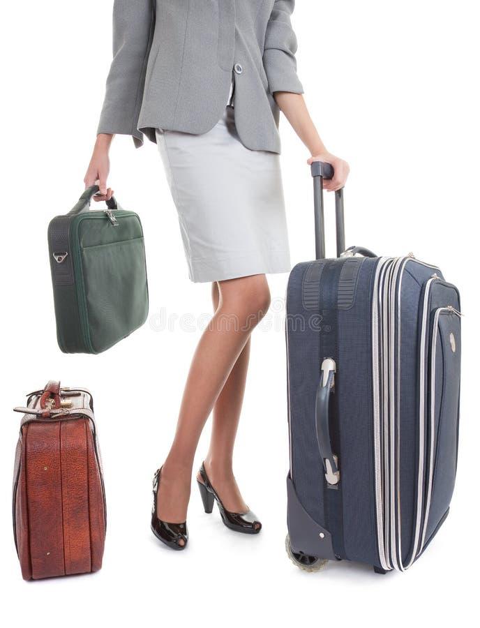 Frau mit einem Gepäck stockfotos