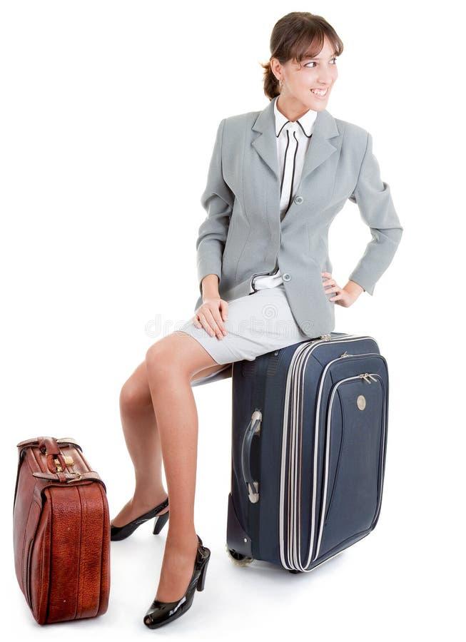 Frau mit einem Gepäck stockbild