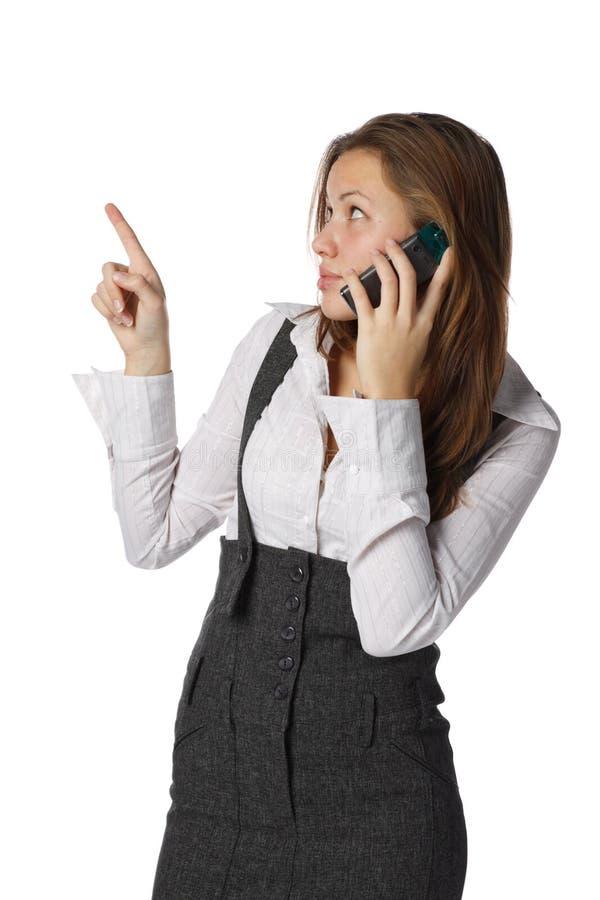 Frau mit einem Handy lizenzfreies stockfoto