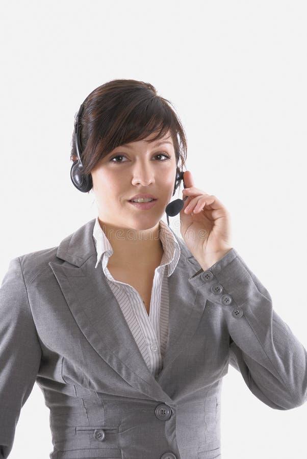 Frau mit einem Kopfhörer lizenzfreies stockfoto