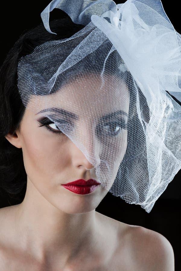 Frau mit einem Schleier stockfoto