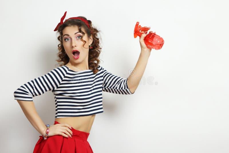 Frau mit einem Spray lizenzfreie stockfotografie