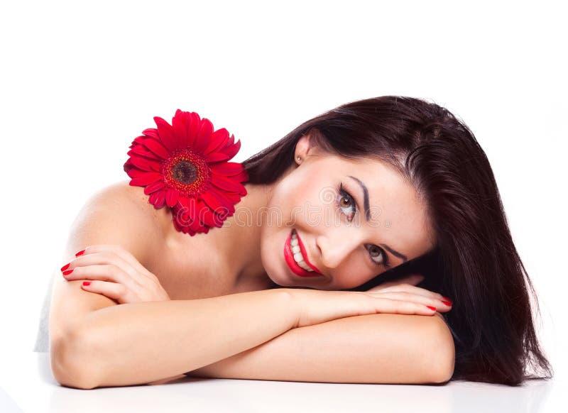 Frau mit einer Blume lizenzfreie stockfotos