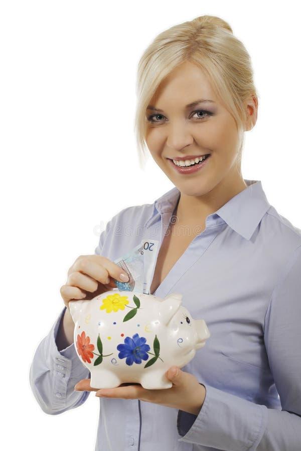 Frau mit Einsparungensschwein stockbilder