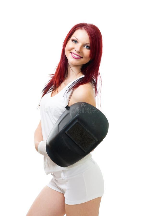 Frau mit Farbenhaar- und -schweißerschablone stockfotos