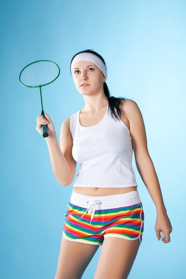 Frau mit Federballschläger lizenzfreie stockbilder