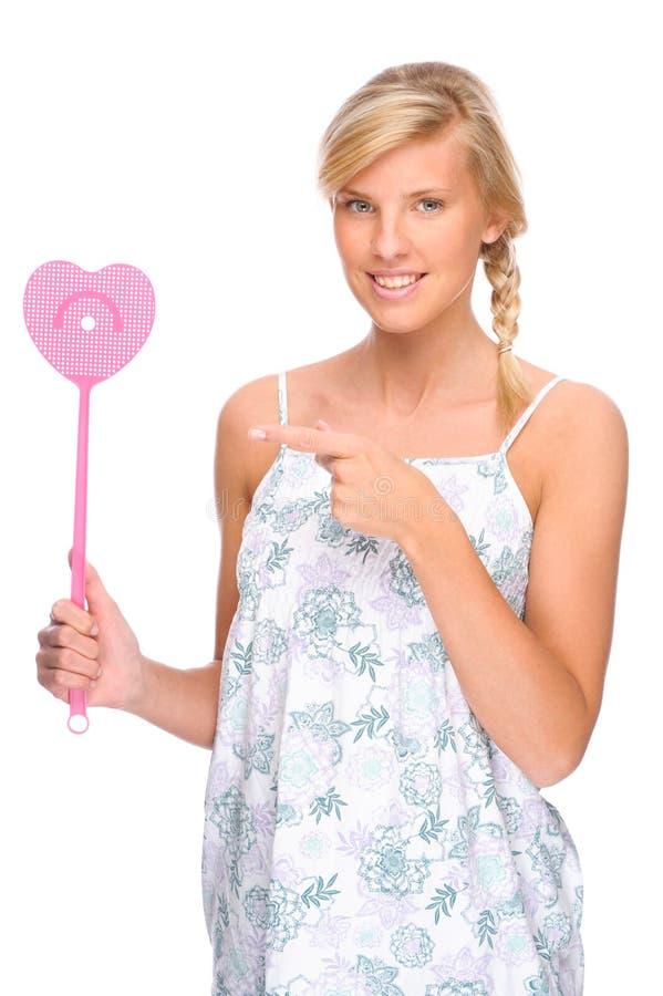 Frau mit Fliege Swatter stockfotos
