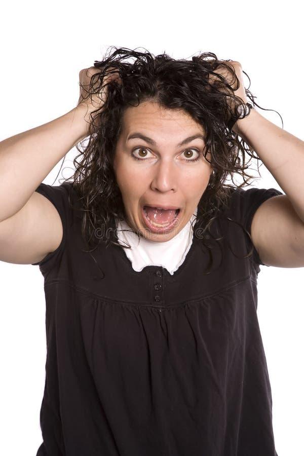Frau mit frazzled Gesichtsausdruck lizenzfreie stockbilder