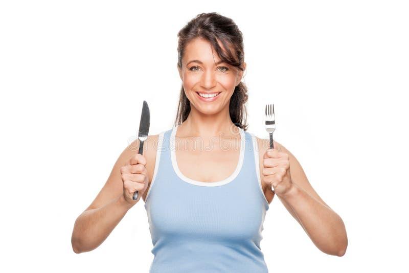 Frau mit Gabel und Messer stockfoto
