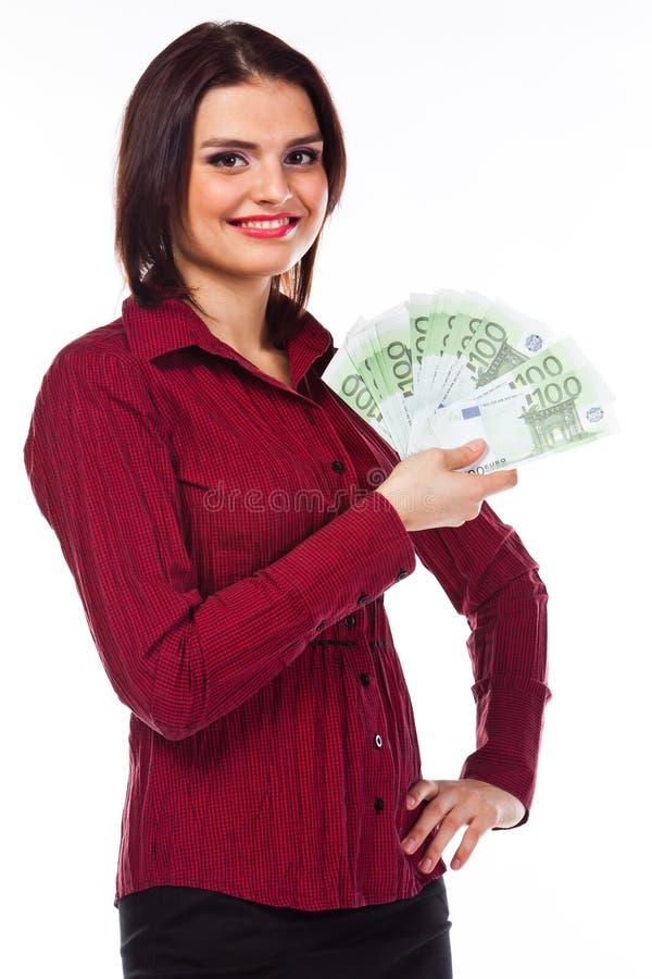 Frau mit Geld lizenzfreie stockfotos