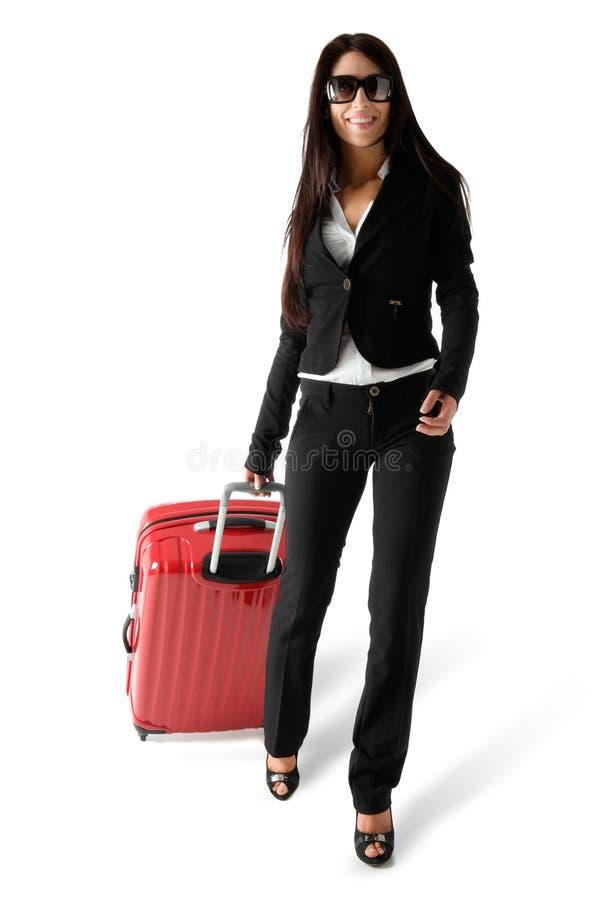 Frau mit Gepäck stockfotografie