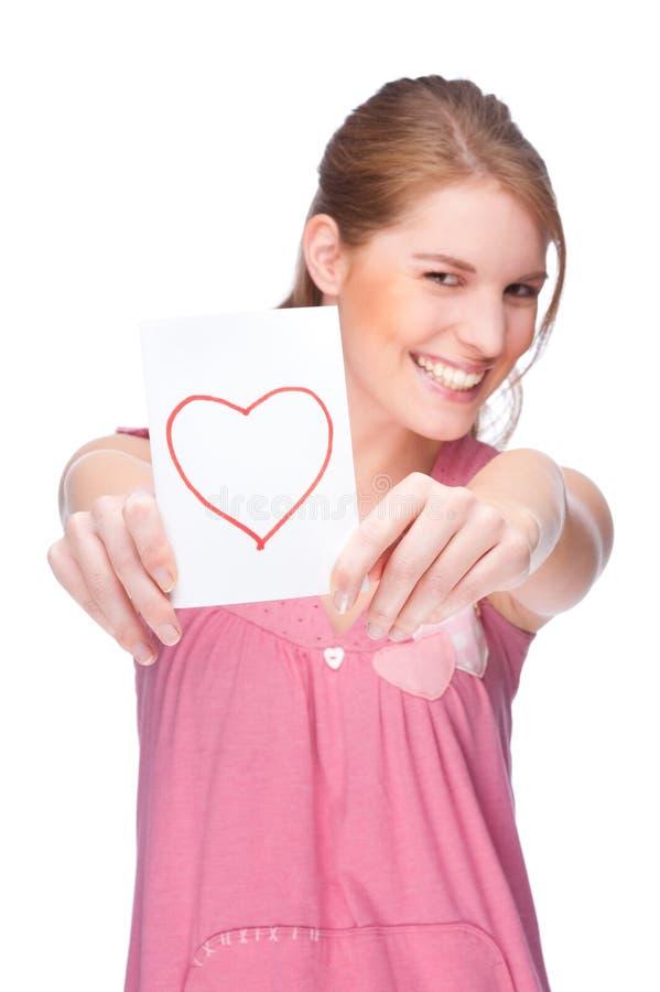 Frau mit Grußkarte stockfotos