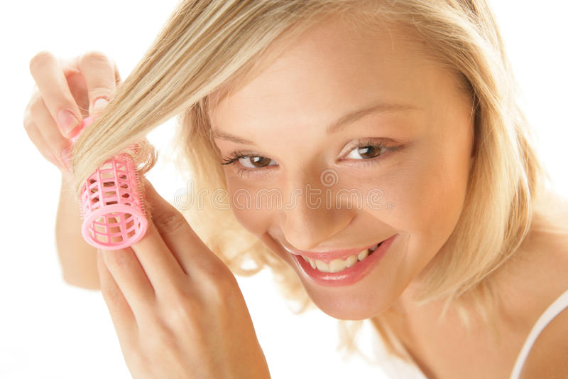Frau mit Haarrolle stockfotos