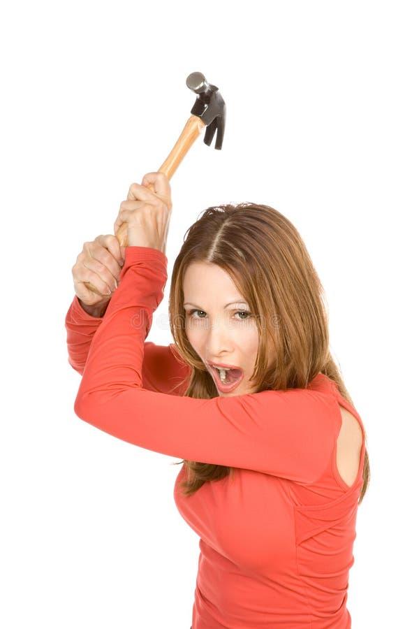 Frau mit Hammer stockbilder