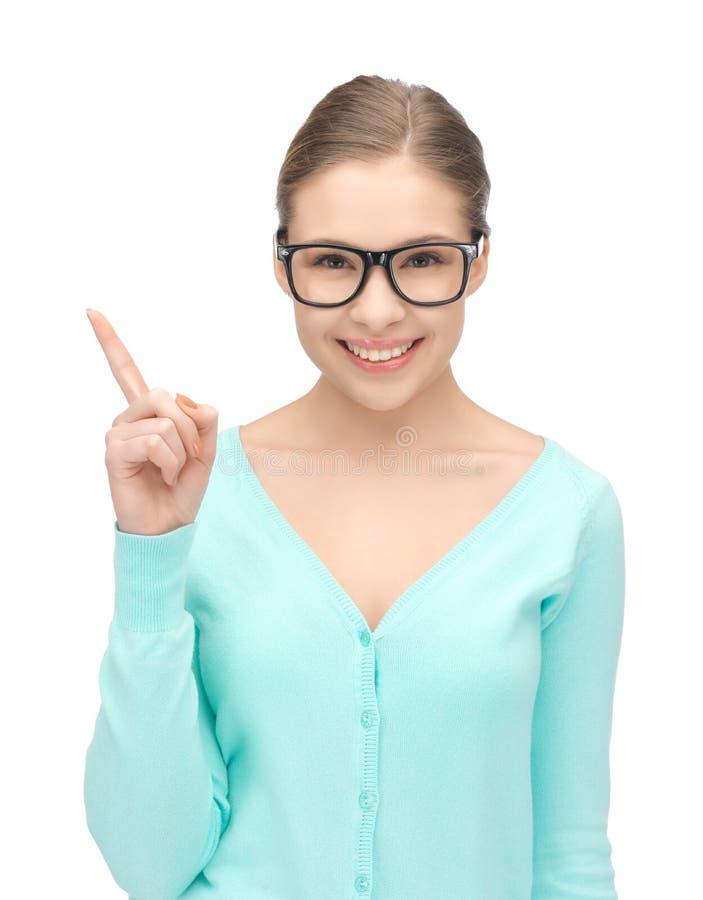 Frau mit ihrem Finger oben lizenzfreie stockfotos