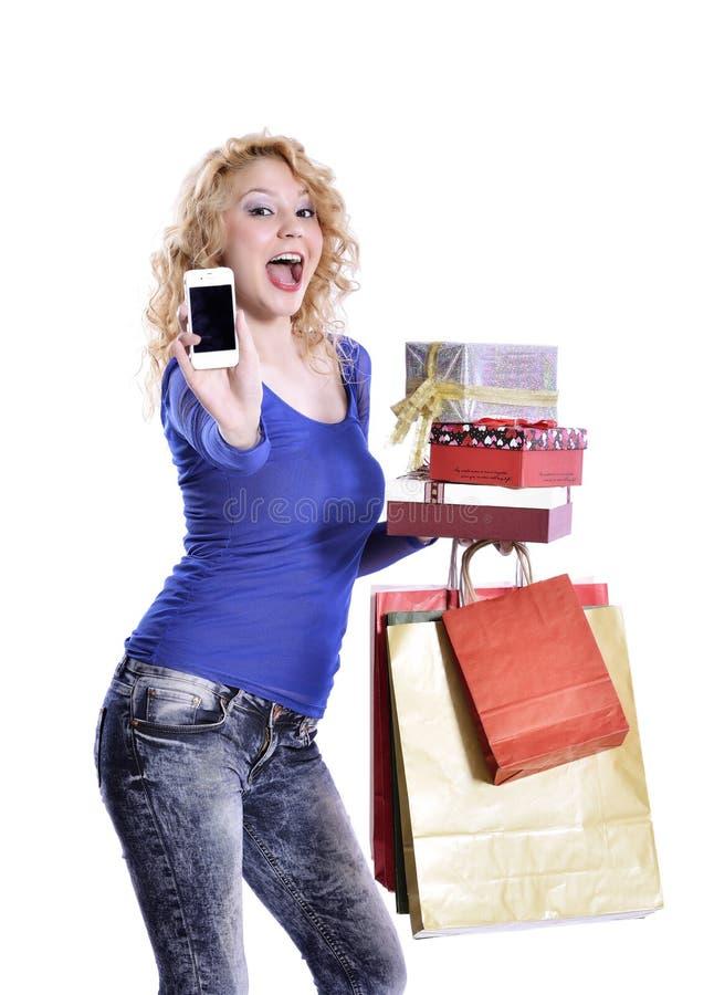Frau mit intelligentem Telefon stockfotografie