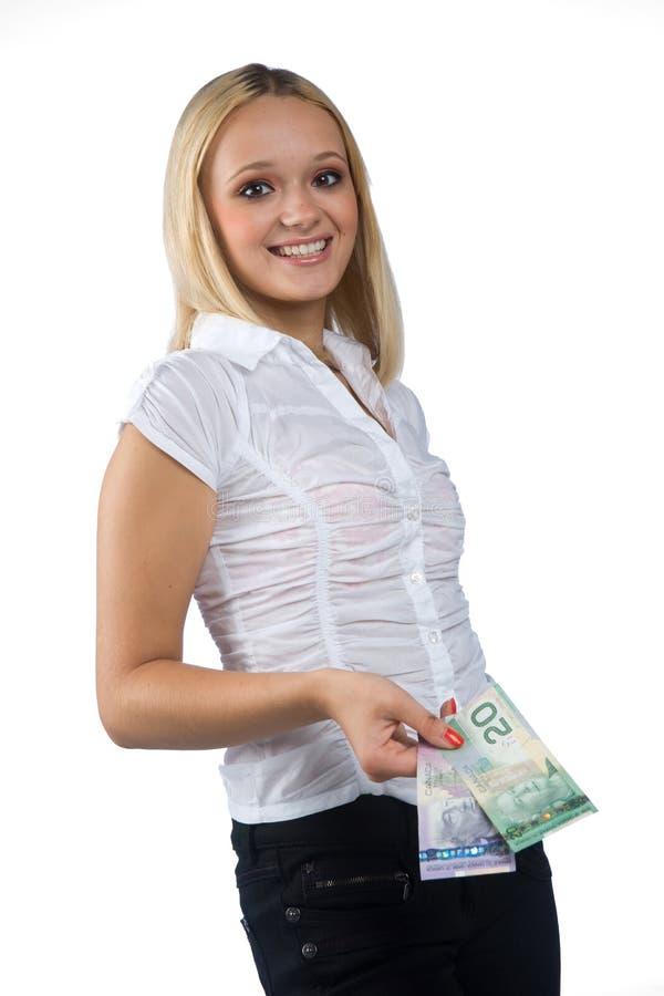 Frau mit kanadischen Dollarscheinen lizenzfreie stockbilder